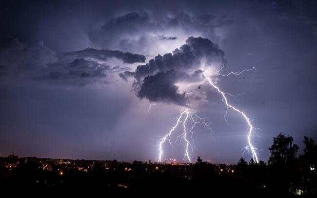 Lightning strikes from a cloud during a thunderstorm above the city of Goerlitz, eastern Germany early Sunday, Aug. 4, 2013. (AP Photo/dpa, Florian Gaertner).