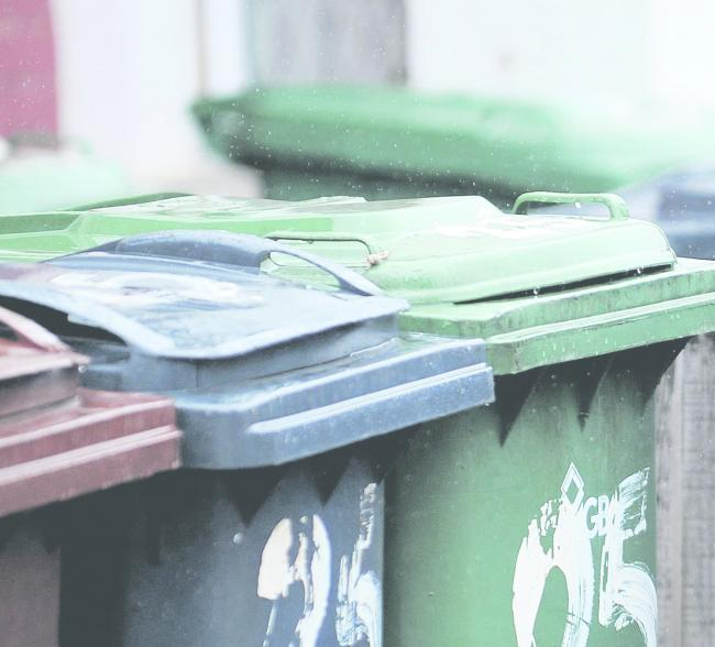 File photo dated 05/08/2008 of a general view of recycling wheelie bins in Harrow, Middlesex..