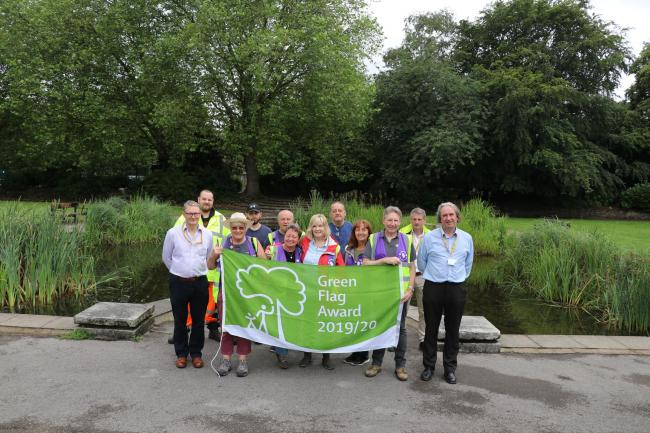 Friends of Davyhulme Park with One Trafford's green space officers and grounds maintenance teams with their recently awarded Green Flag.