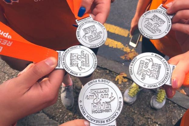 The medals handed out for people who completed the 5k in Jude's memory