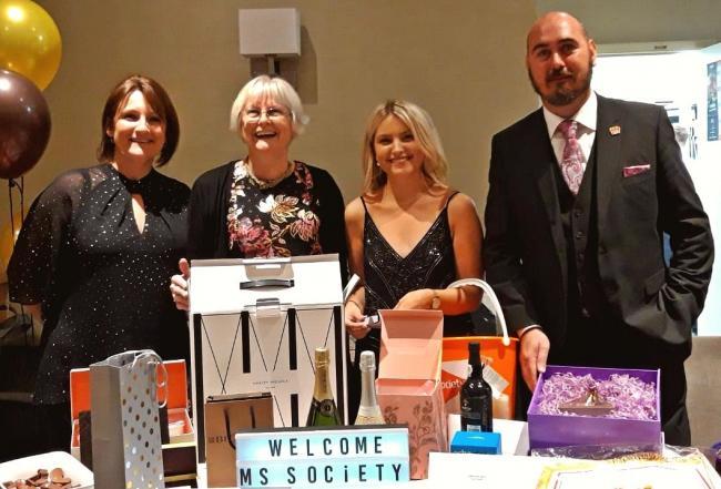 MS Society event organisers Elaine Radford, Karen Pennington and Amy Thompson with Wayne Devlin