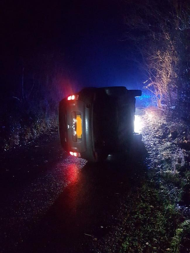 A car on its side, posted by North Yorkshire Police