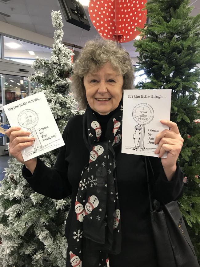 Sue Dempsey with her books