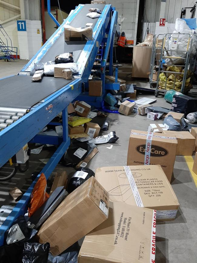 Hermes launches investigation as leaked photos show packages strewn across depot floor