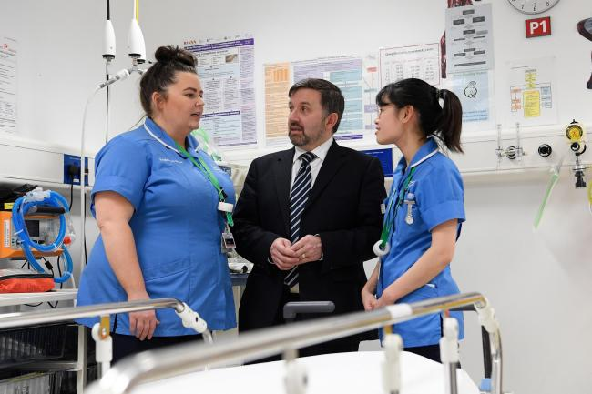 Robin Swann with nurses