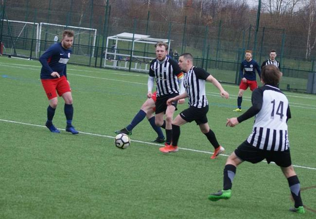 Action from the meeting between Parrs Wood Celtic and Salford Storm, in red and blue