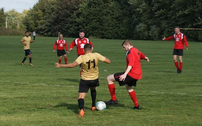 Pics Flixton JFC in action (in red) in a local derby with Urmston Town