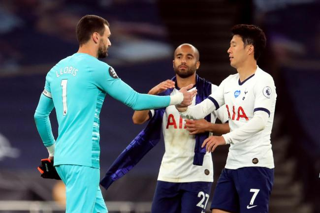 Hugo Lloris, left, and Son Heung-min make up after clashing at half-time