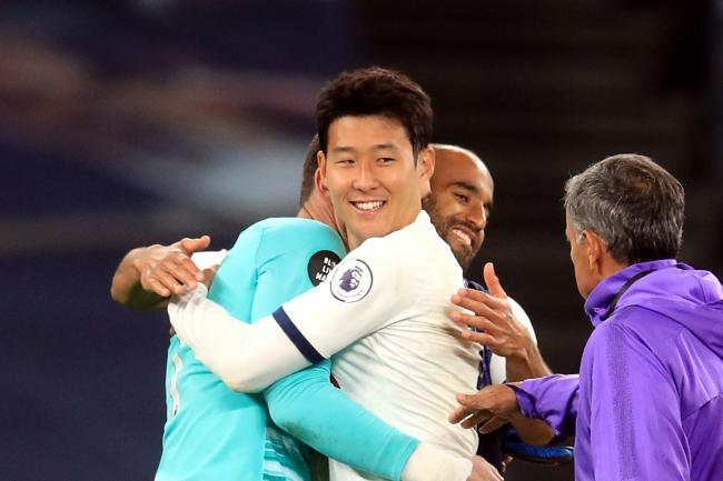 Spurs team-mates Hugo Lloris and Son Heung-min embrace after a clash earlier in the game