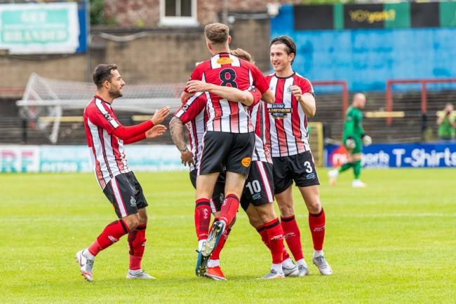 Altrincham players celebrate Josh Hancock's opening goal in the 2-0 win over York City at Bootham Crescent on Saturday. Pictures: Michael Ripley