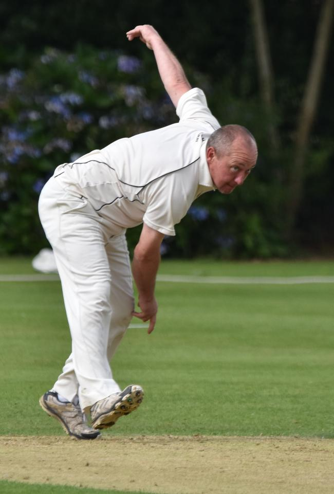 Lee Heap bowling for Ashton on Mersey