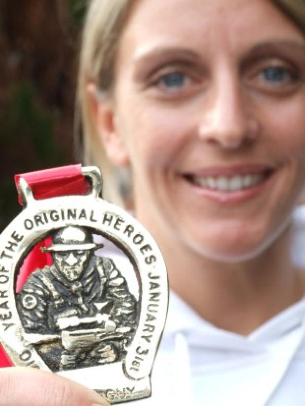 Messenger Newspapers: Second to none: tough girl Lisa Foley with her winner's medal.