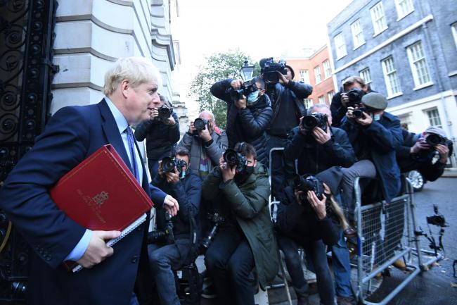 Prime Minister Boris Johnson leaves a Cabinet meeting at the Foreign and Commonwealth Office, London. PA Photo. Picture date: Tuesday October 20, 2020. See PA story HEALTH Coronavirus. Photo credit should read: Stefan Rousseau/PA Wire