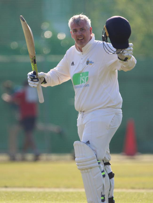 Mike Bishop celebrates his century. Picture: George Franks