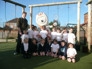 Olympic mascot Wenlock with teacher Matthew Payne and pupils