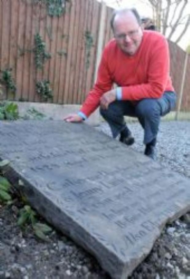 Messenger Newspapers: The Rev Peter Geddes examining the headstone