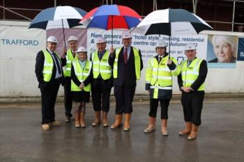 MP Graham Brady (centre) tours construction site for a new care home