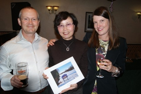 Soonja is presented with her present by David and Janice Weyer