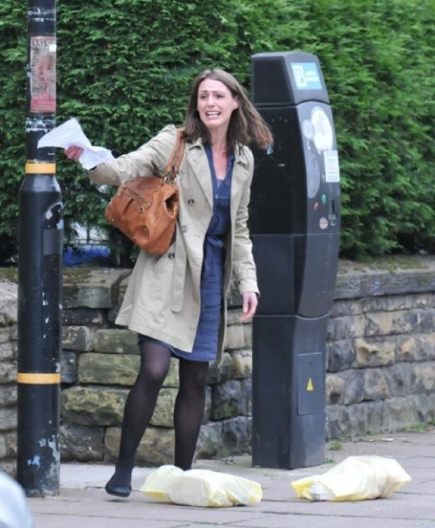 Caption - Suranne Jones during filming in Oxford Road.