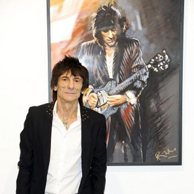 Rolling Stones guitarist Ronnie Wood at his new art exhibit Faces, Time and Places (AP/Evan Agostini)