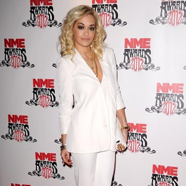 Rita Ora has denied rumours she is dating Drake