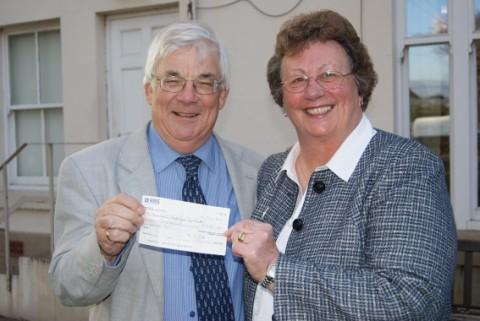 Sylvia hands over the cheque to Professor Webb