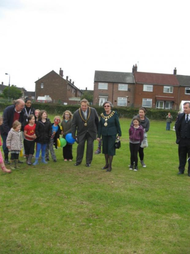 The Mayor, Cllr Patricia Young, taking part in the wellie throwing event