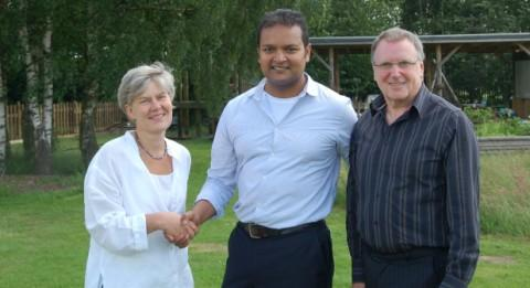 Mal Choudhury (centre) with MP Kate Green and Cllr David Acton