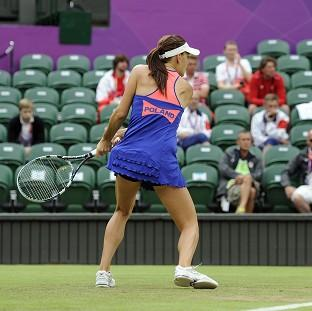 Poland's Agnieszka Radwanska plays in front of empty seats during the tennis at Wimbledon