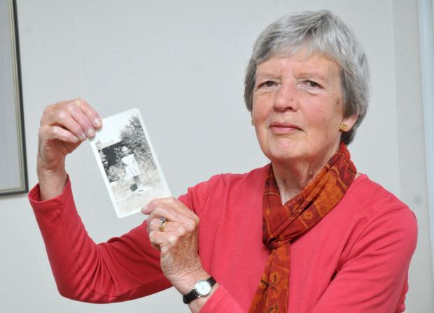Ruth Elliot with a picture of herself as a child