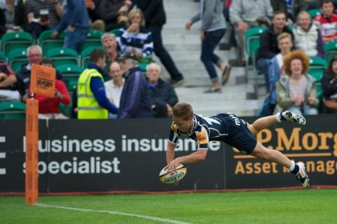 Jack Walsh of Sale Sharks scores a try against Saracens 7s at the Recreation Ground, Bath in the final round of the J.p. Morgan Asset Management Premiership Rugby 7s Series