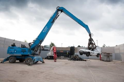A car is crushed with the hi-tech equipment at J Davidson's new premises