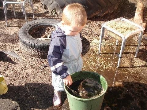 Nursery children enjoy getting messy with nature