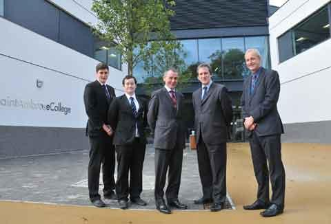 Students Patrick Hatchman, Matthew Trainor, headmaster Michael Thompson and MP Damian Hinds and head of politics David Lindsay.