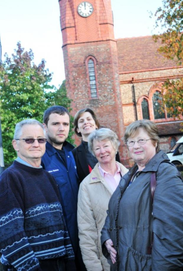 (from the left) Nigel, Davies, church warden, Mattthew Warburton of Smith and Derby, who repaired the clock, the Rev Libby Lane, warden Norma Entwisle and verger Judy Holden
