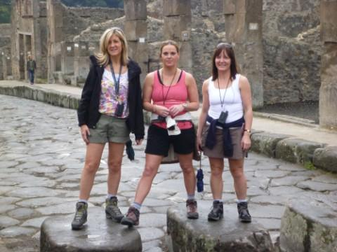 Up for the challenge - Lisa (far right) with fellow team members Simone Breedon and Nicola Taylor-Jones in Pompeii before the group started their ascent of Vesuvius.