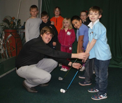 James Salt is pictured at work with youngsters at the gol