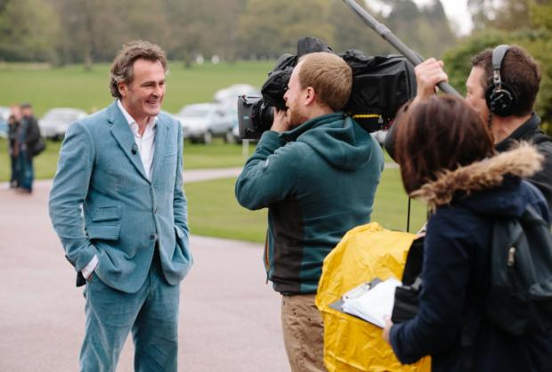 Flog It! host Paul Martin records a piece to camera