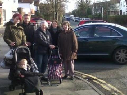 Cllr Wilkinson with residents at the A56/Park Road junction