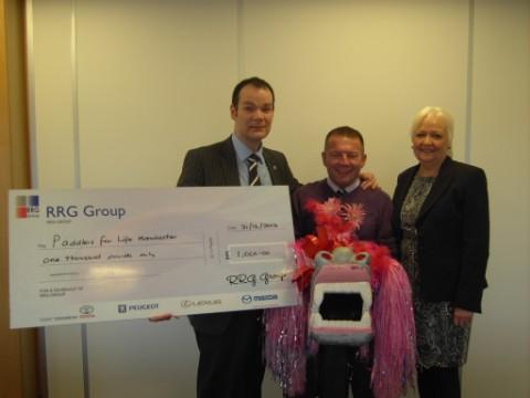 Joint managing directors, RRG, Arran Bangham and Tony Cliff present the donation to Ann Johnson