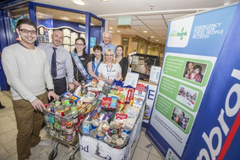 Phil Whitman, left from Salford Central Foodbank collects the donation from manager Mike Doyle, Victoria Green, Lisa Chorlton, Karen Marsh Claire Sahill and Paul Holt, back