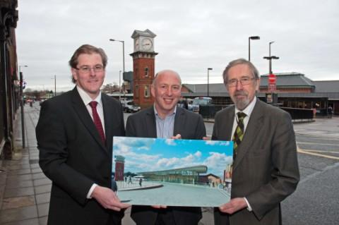 (left to right) Council leader Cllr Matt Colledge, Tom Higgins, leader for Laing O'Rourke's construction business in the north, and Cllr Andrew Fender, chairman of the TfGM committee, show the artist impression of the refurbished interchange