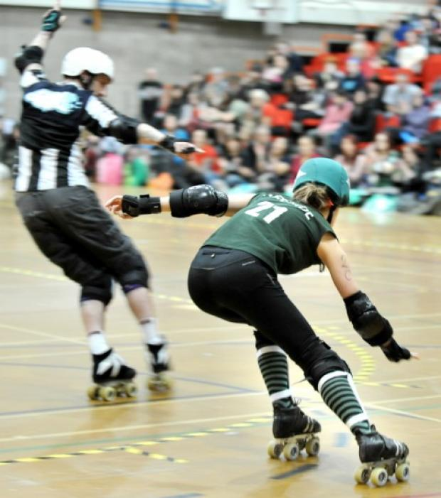 """Manchester's A-team captain, Sirenide, in action in her green colours. Photo by Shirlaine Forrest"