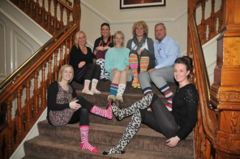 The Priory staff in their socks