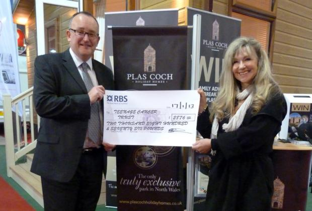 Dean Styger hands over the cheque to Sue Jenkins