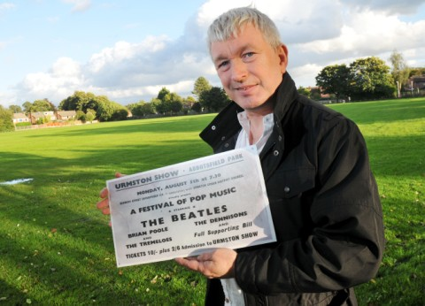 Peter Killick at Abbotsfield Park with a copy of an original Urmston Show ticket. Photo provided by Paul Wilde.