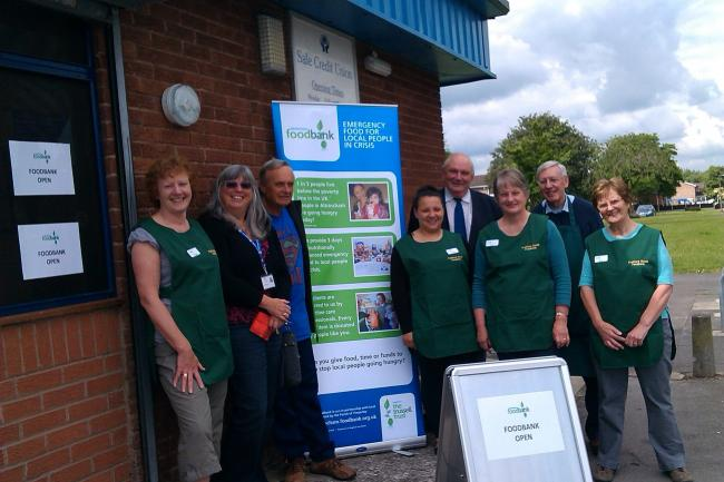 Foodbank volunteers Vivien Clifton, Roger Snowden, Lorien Losada, Fran Raynor, Chris Raynor and June Clowes, with Cllr John Holden