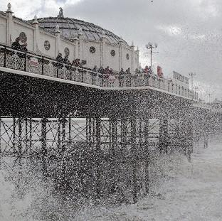 Messenger Newspapers: Waves crash near Brighton Pier in East Sussex, as England and Wales face a battering from the worst storm in five years