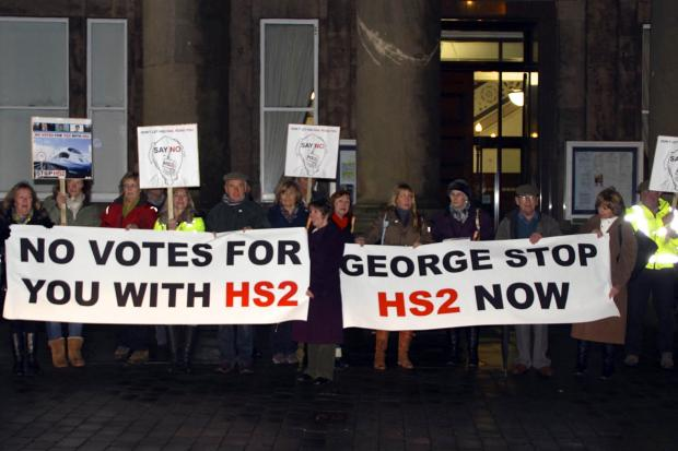 Anti-HS2 protesters wait to make their point to Chancellor George Osborne