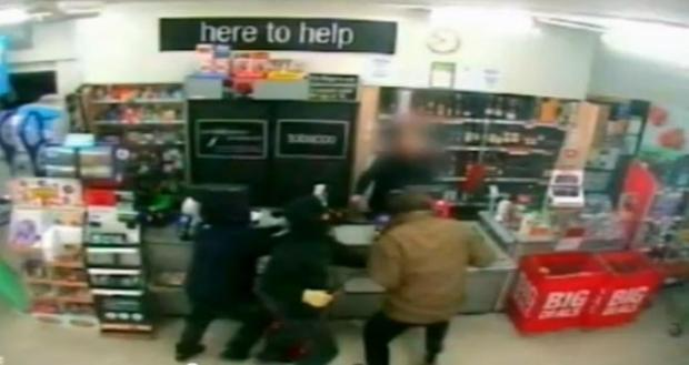 Police release CCTV after three robbers armed with machete and hammers raid Partington Co-op